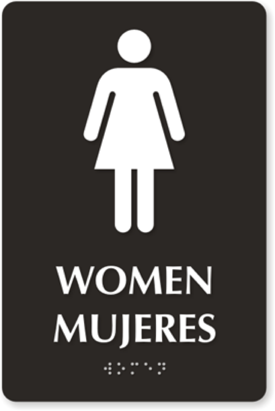 """A bathroom sign that indicates gender in multiple languages. In English, it says """"Women."""" In Spanish, it says """"Mujeres."""" The information is also replicated in braille. Above these is a pictogram of a woman."""