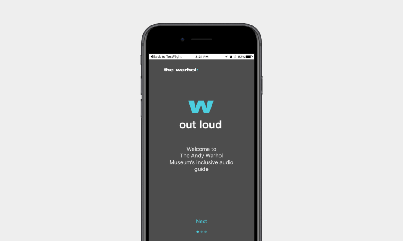"""A light blue W, followed by the text """"out loud,"""" and """"Welcome to the Andy Warhol Museums inclusive audio guide"""""""