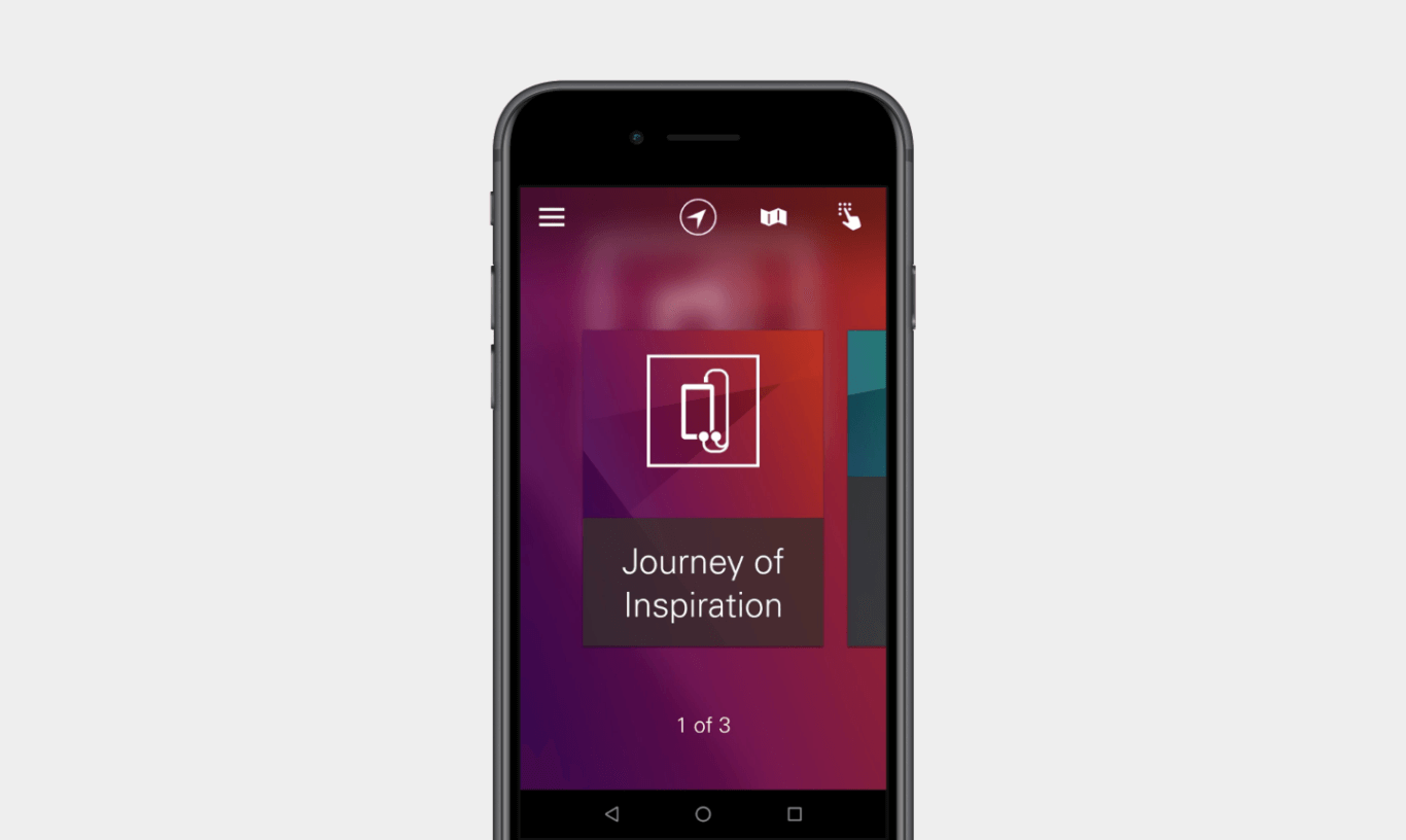 """A text box with the words, """"Journey of Inspiration,"""" placed below an icon of a mobile phone and headphones, is displayed on a mobile phone."""