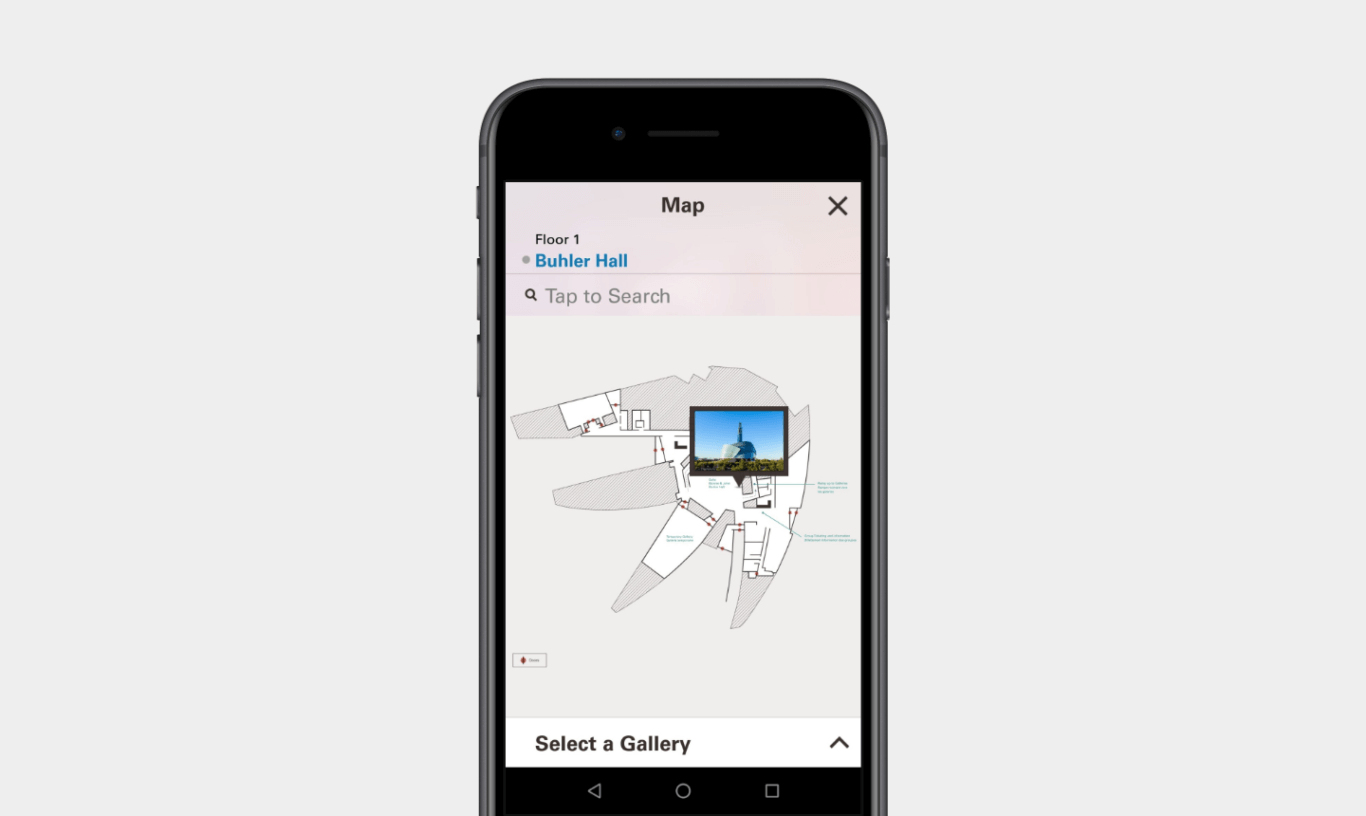 """A mobile phone mockup of a map of an unusually shaped, four-elled building is overlaid with a small, blue thumbnail. The map is labeled """"Floor 1: Buhler Hall."""" There is also a search field and X to close the window."""